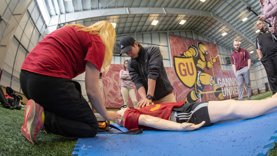 Master of Athletic Trianing Students in Fieldhouse